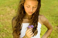 Close-up of a girl holding a flower