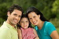 Portrait of parents and their daughter smiling