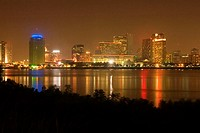 Buildings in a city lit up at night, New Orleans, Louisiana, USA