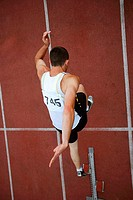 Male Runner Leaping Off Starting Blocks