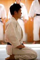 Judo Master Kneeling On a Mat