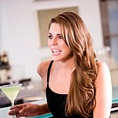 Close-up of a young woman holding a glass of cocktail