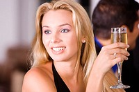 Close-up of a young woman holding a glass of champagne