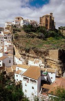 Setenil de las Bodegas. Nuestra Señora de la Encarnación Parish church and ruins of the Arab walls (XII-XIIIth centuries). Cádiz province. Andalusia. ...