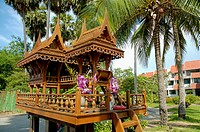 Thailand, Wooden spirit house at entrance to condominium