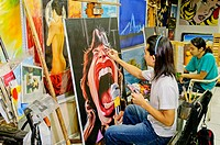 Thailand, Pattaya, Skilled painters copy all kinds of paintings, from famous pieces of art to reproductions of personal photographs at reasonable pric...
