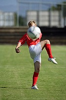 Soccer Player Kicking Ball At the Camera