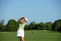 Female Golfer Making a Drive