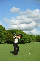 Male Golfer Making a Chip Shot
