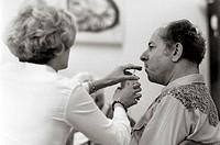 Nurse feeding an elderly Alzheimer´s patient who has forgotten how to eat.