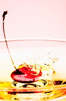 Red cherry in a glass of alcoholic drinks