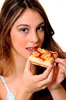 A woman eating a piece of pizza