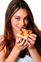 A woman posing with a piece of pizza while looking at the camera (thumbnail)