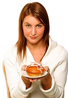 A woman holding up a plate of pastry