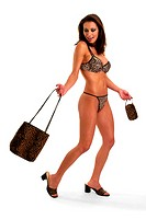 A woman in leopard skin bikini wearing a matching heels and holding matching bags