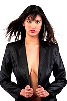 A braless woman wearing a black coat