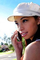 A woman with white cap talking on a handphone