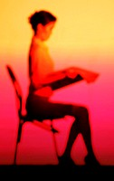 Side shot of business woman sitting on a chair