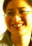 Bespectacled woman with a big smile