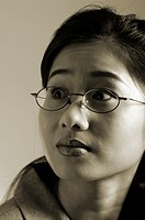 Sepia picture of a bespectacled business woman