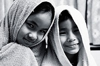 Boy and girl covering their heads with towels