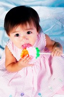 Baby girl licking candy