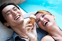 Couple sharing an ice-cream cone