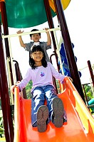 Girl sliding down a slide (thumbnail)