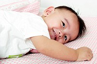 Boy lying on the bed