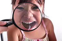 Girl using magnifying glass (thumbnail)
