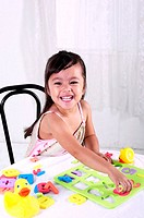 Girl playing with educational toy