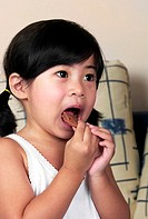Girl eating cookies