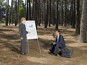 Office workers holding a meeting in forest