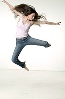 Woman jumping in studio