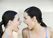Two young women screaming at each other