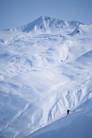 Man snowboarding, Chugach Mountains, Alaska, USA