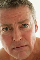 Mature man with scared expression, portrait, close-up