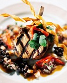 Grilled pork chops with black bean and red pepper salsa, elevated view