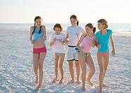 Group of girls dancing on beach