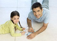 Father and daughter putting together puzzle together