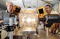 Bulb testing. Researchers test the heat output from a high intensity discharge light bulb. This type of bulb creates light from a plasma discharge rat...