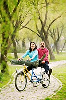 Couple having fun cycling in the park