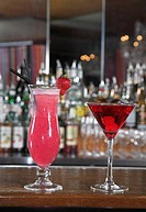 still life of two red coloured cocktails