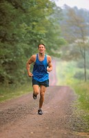 Man running down country road