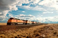 Five diesel electric locomotives pull long train of intermodal trailers through New Mexico, USA