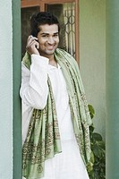 Portrait of a young man talking on a mobile phone (thumbnail)