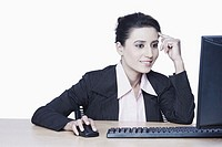 Close-up of a businesswoman working on a computer