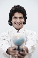 Portrait of a businessman holding a globe
