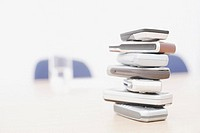 Close-up of a stack of mobile phones