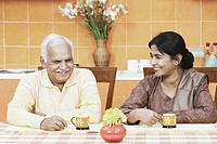 Mature couple having tea at the dining table